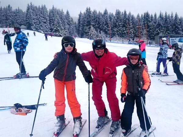 Samen met de skileraar op de foto
