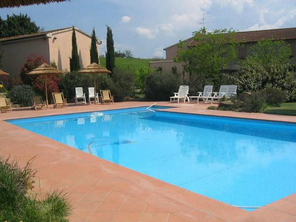 Zwembad van agriturismo La Maremma