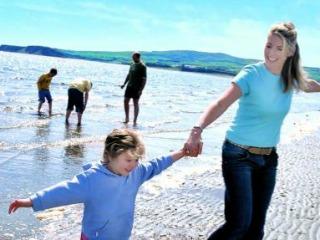 Plezier op Ayrshire strand