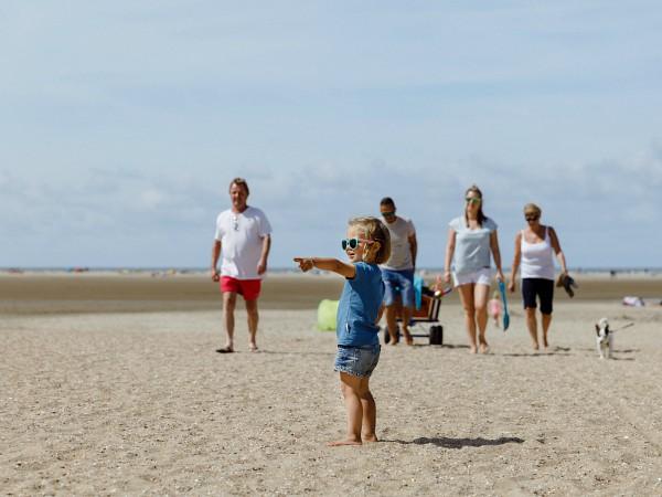 Gezin op het strand