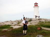 Bag Piper at Cove by Bill Davenport